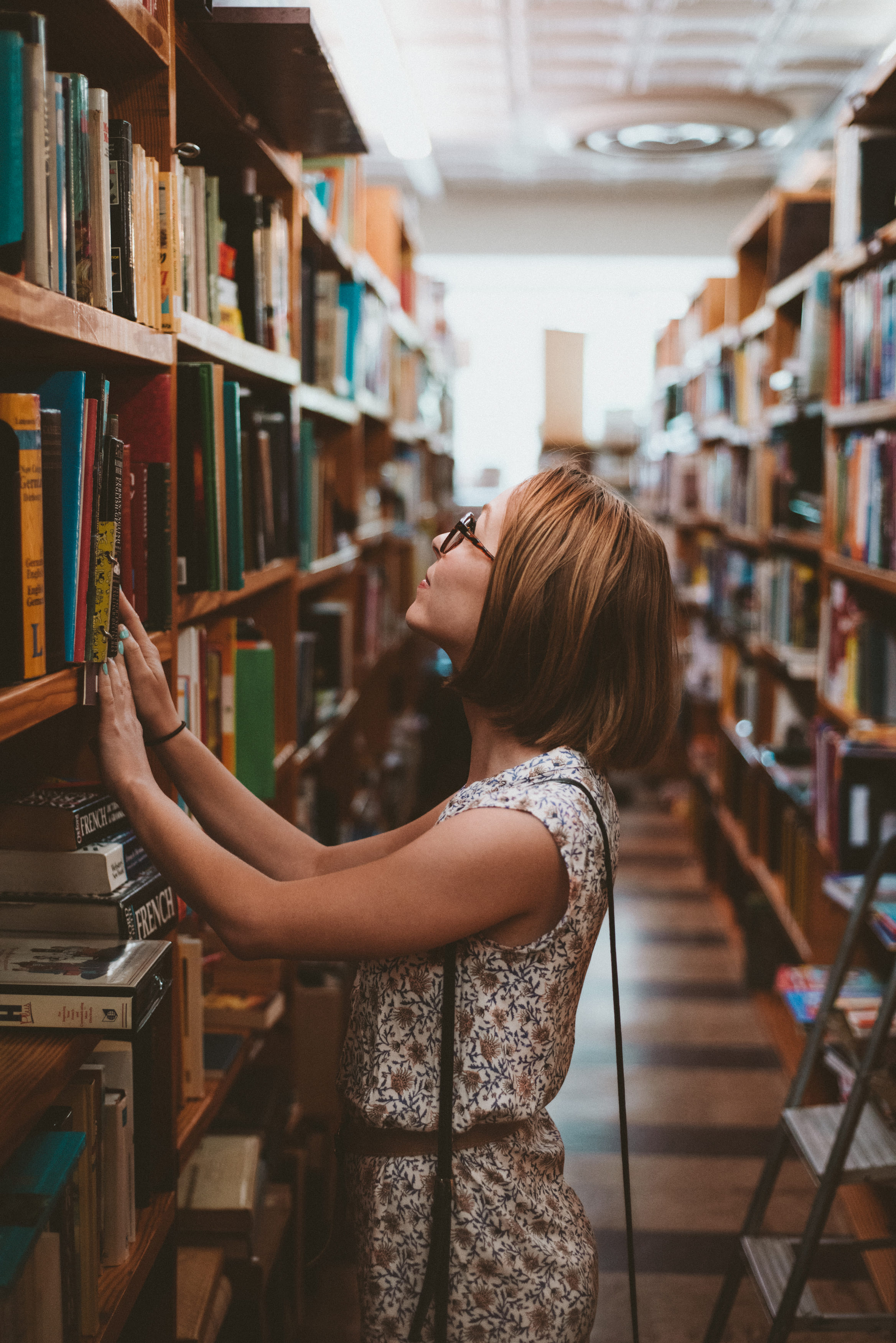 Woman in library searching for book