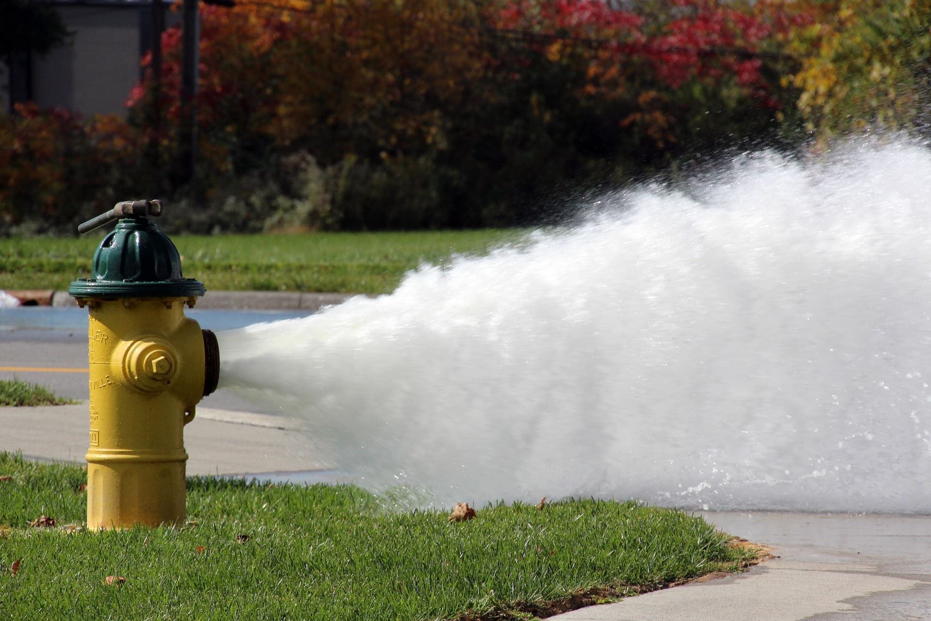 open fire hydrant is releasing water
